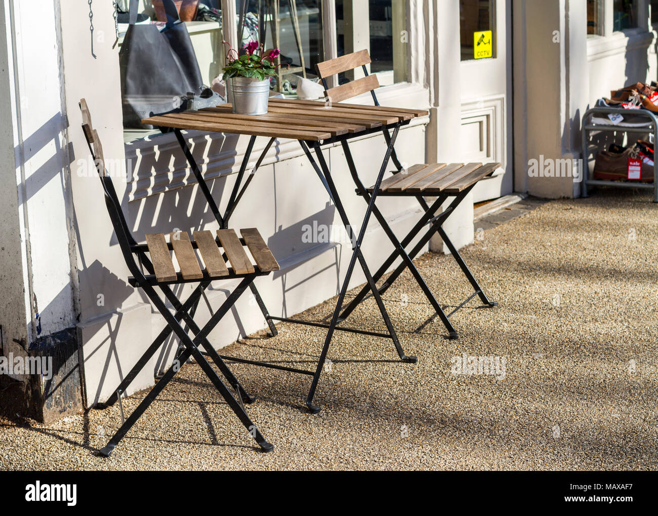 https www alamy com empty wooden table and chairs outside a coffee shop on a bright sunny day london uk image178829259 html