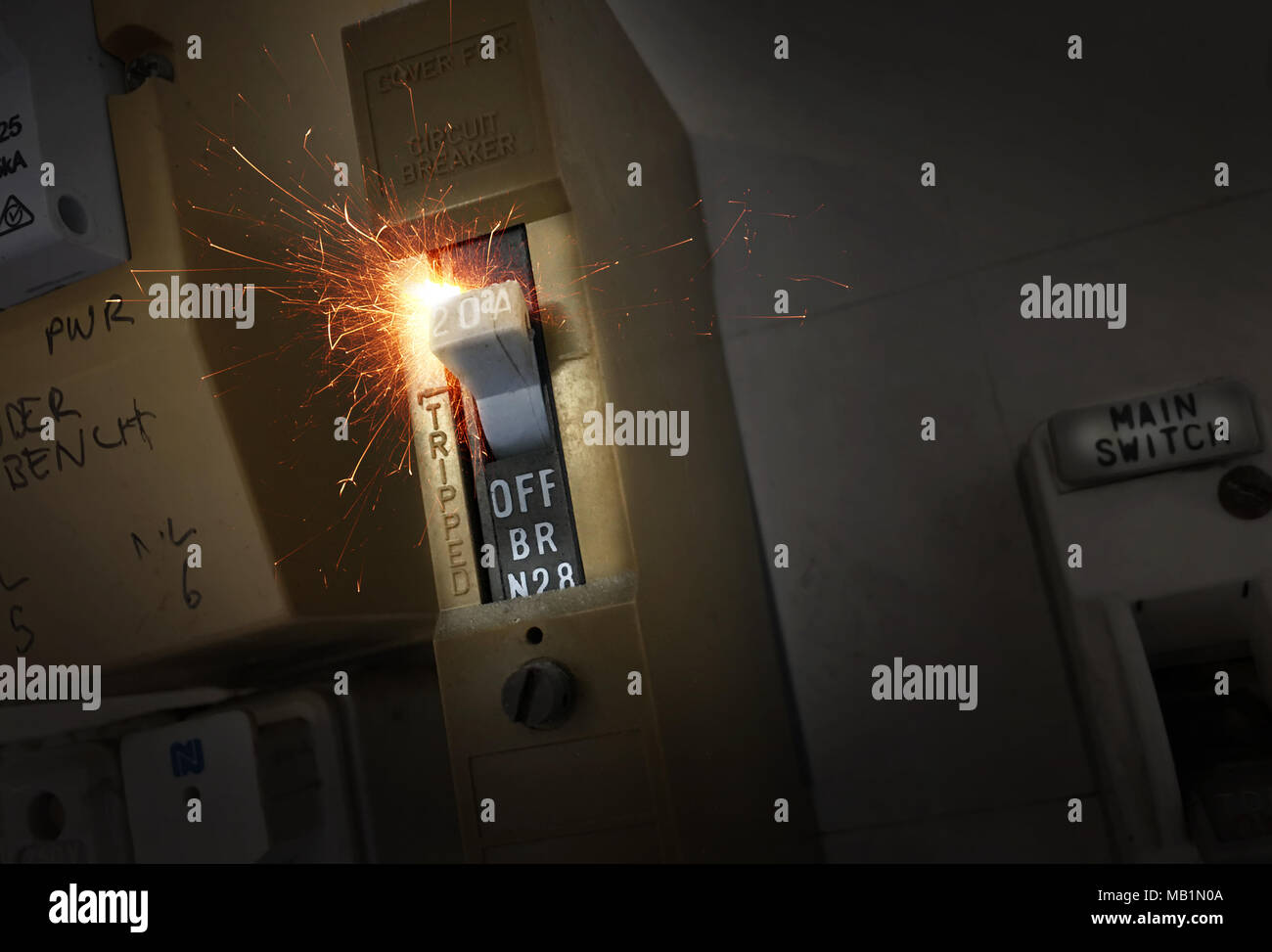 hight resolution of sparks flying from an old electrical switch which causes a house fire stock image