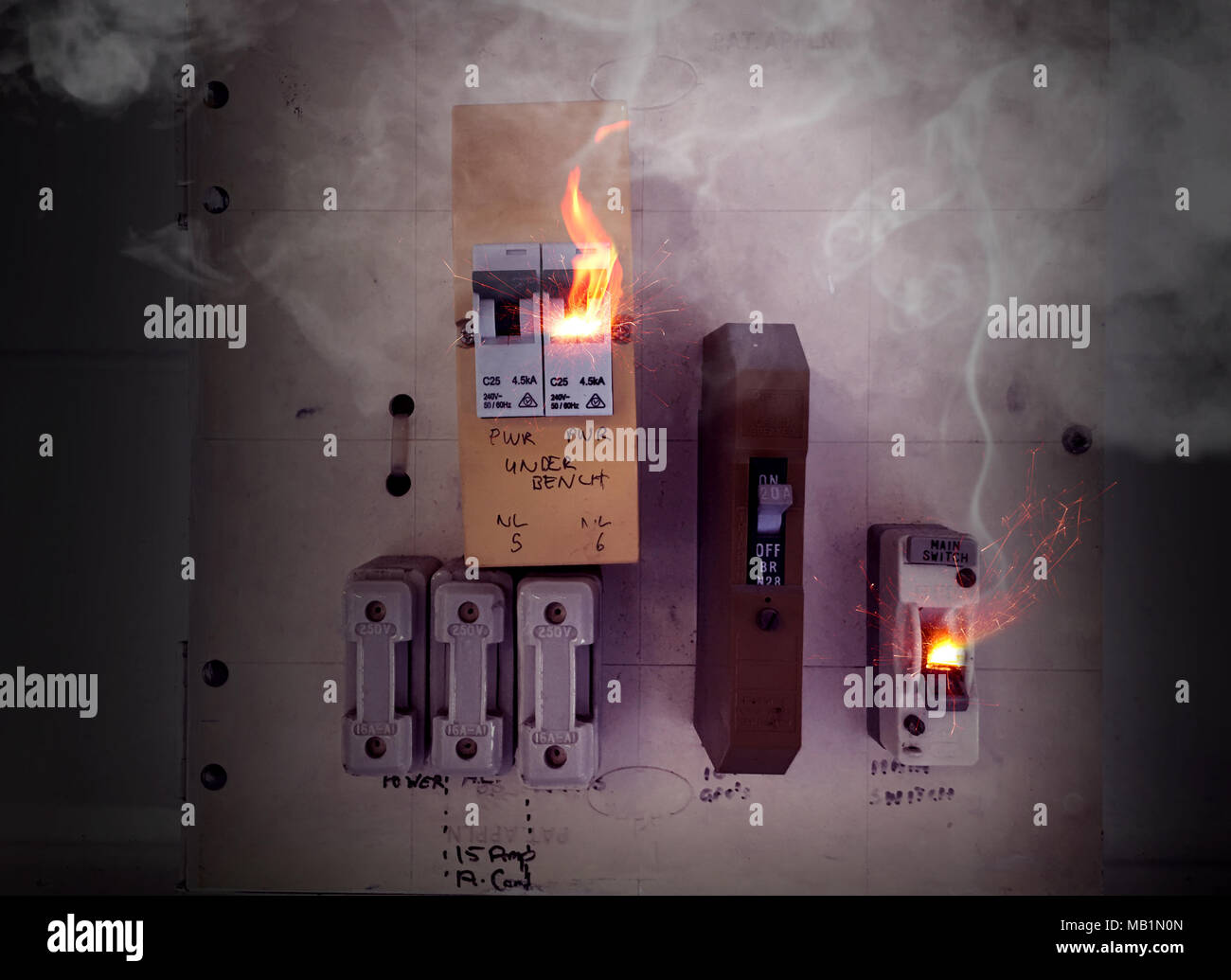 hight resolution of sparks and flames coming from an old electrical switch box causing a fire stock image