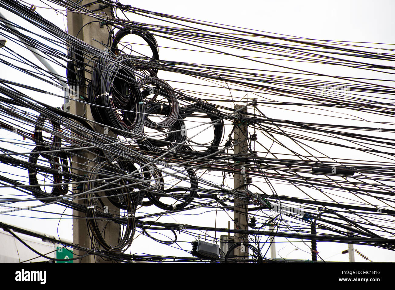 hight resolution of many wires messy with power line cables transformers and phone lines on old electricity pillar or utility pole at beside road in bangkok thailand