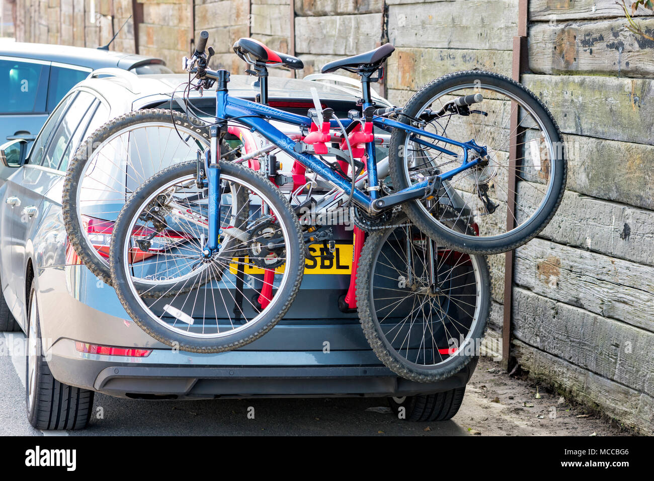 https www alamy com two bikes loaded on to a rack on the back of a car image179752054 html