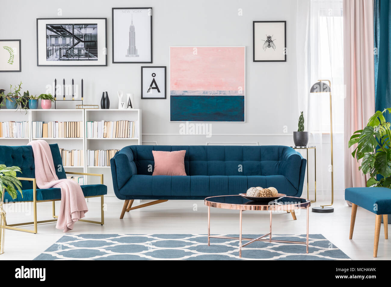 contemporary living room art what size recessed lights for modern interior with blue sofa rug collection and pink details