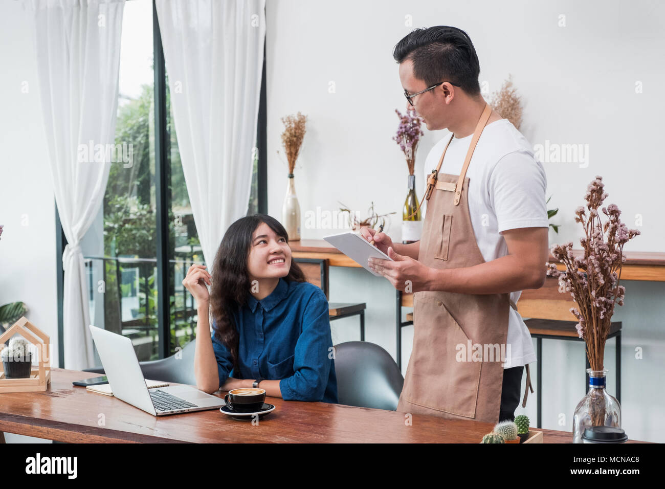 Asia Barista Waiter Use Tablet Take Order From Customer In