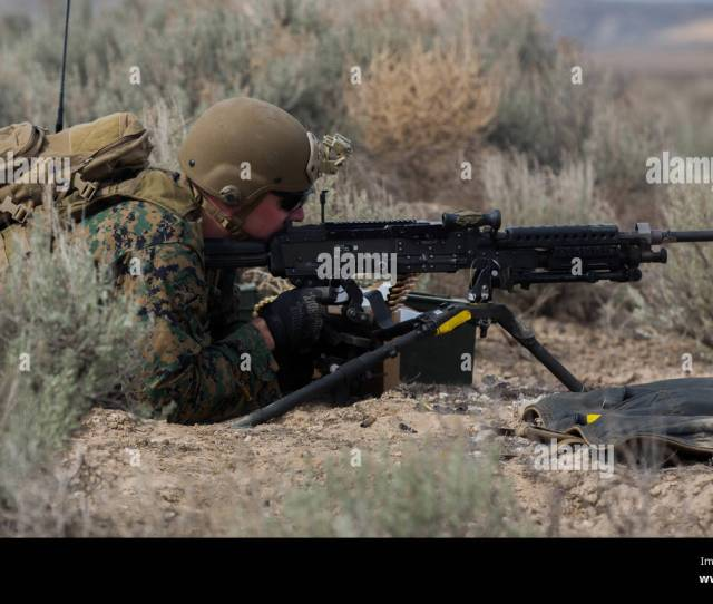 U S Marine Corps Lance Cpl Adam Eberhardt A Field Radio Operator With 1st Air Naval Gunfire Liaison Company Mark Targets With An M240b Machine Gun While