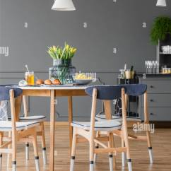 Dark Kitchen Table Grill Pastries And Honey Jar On A Minimalist Wooden Modern White Navy Blue Chairs In Dining Room Interior With Gray Walls