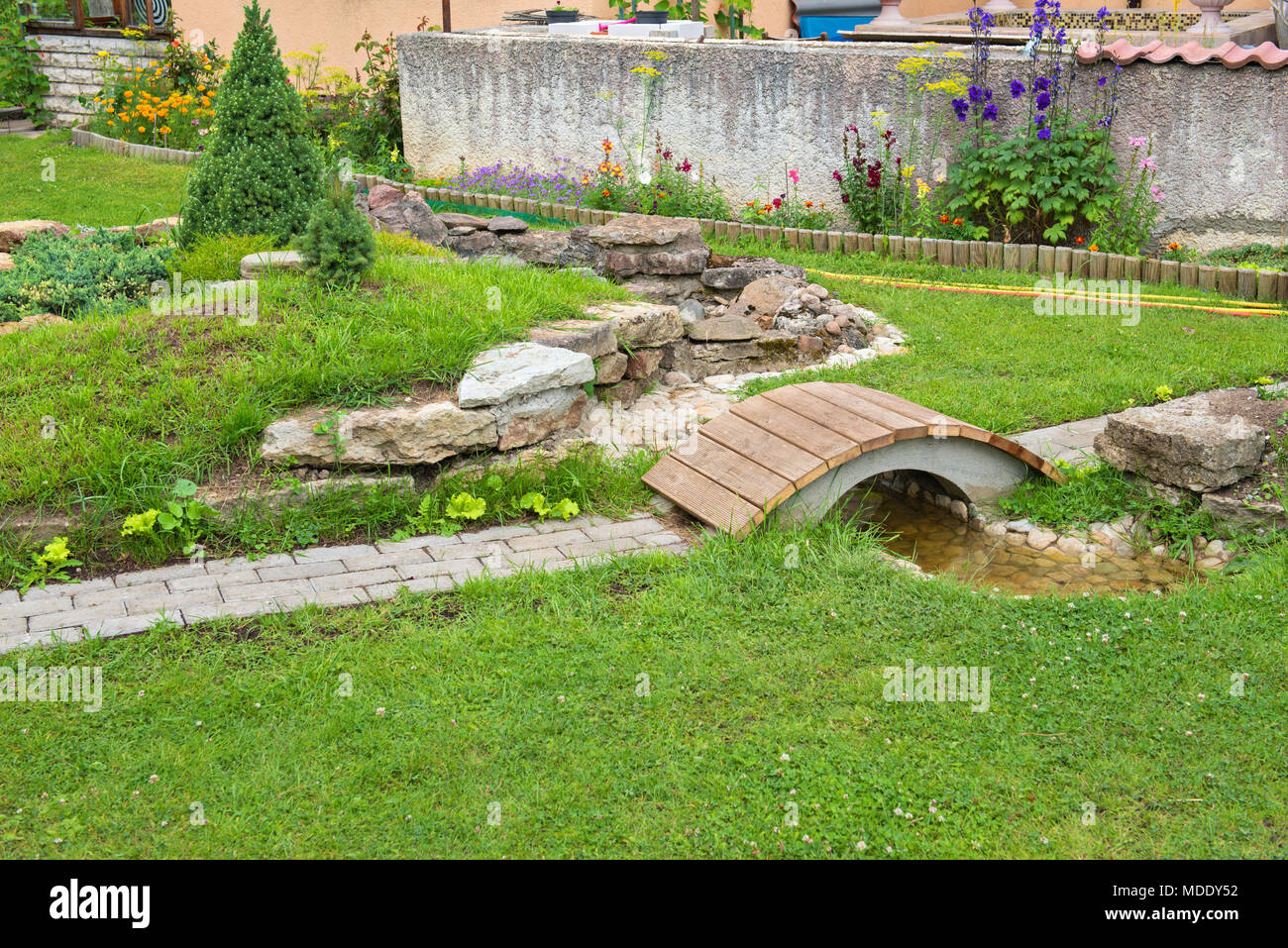 Modern Garden Design Rock Garden With Pond In Summer Stock Photo Alamy