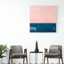 Grey Modern Armchairs Serta Jennings Chair Review Plant On A Table Between In Interior With Pink And Blue Painting White Wall