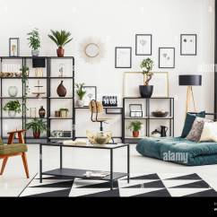 Living Room Mattress Bohemian Home Office Corner With Desk And Laptop In White Interior Folded Sofa Fresh Plants Metal Rack