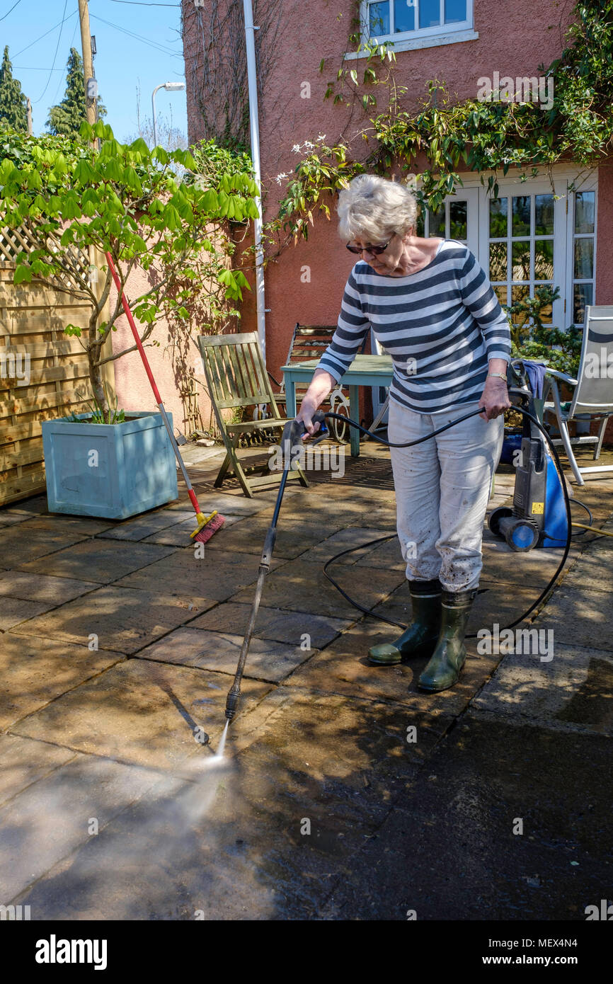 https www alamy com older woman spray cleaning patio with pressure washer on garden england ukuk image181283344 html