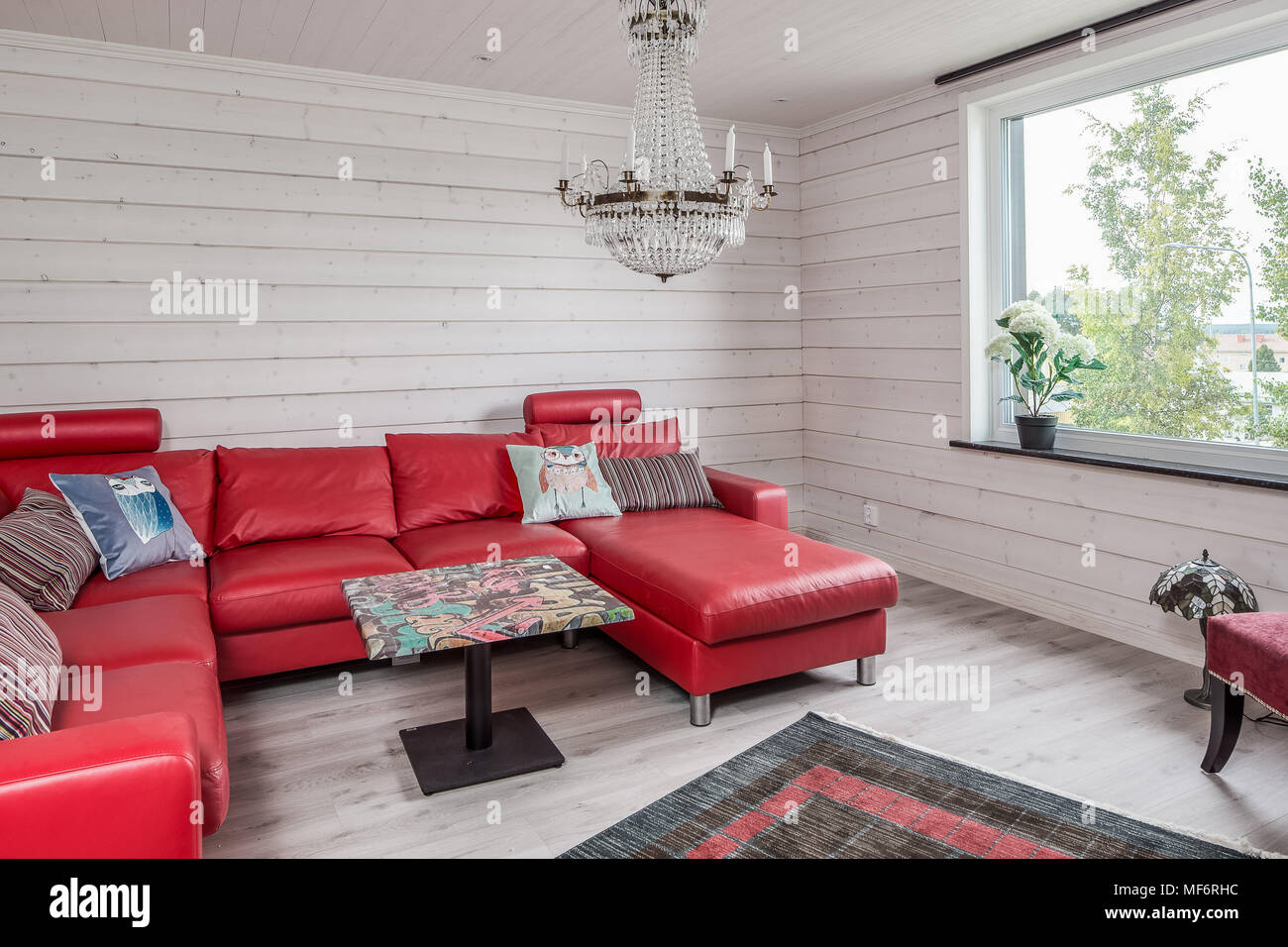 red sofa white living room modern coffee tables with wood wall panels chandelier and a
