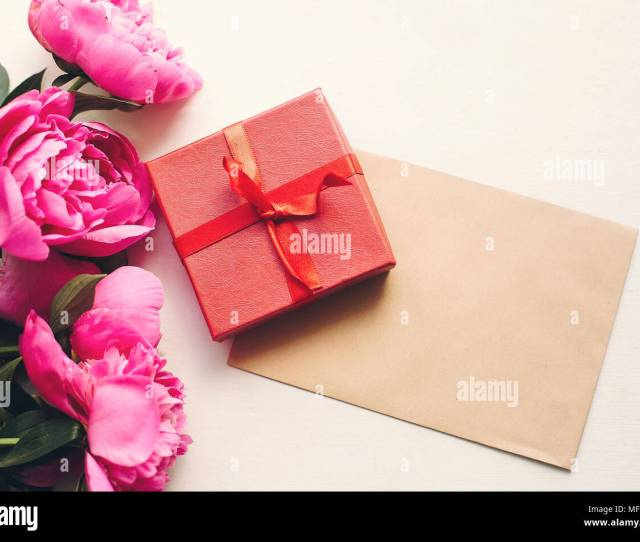Lovely Pink Peonies With Empty Craft Card And Red Gift Box On Rustic White Wooden Background Top View Space For Text Floral Greeting Card Mock Up H
