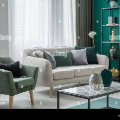 Living Room Decorative Pillows Small With Sectional Couch Green And Silver Placed On A Light Grey Standing In Interior Windows Armchair Marble Table