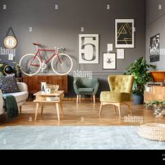 Pouf In Living Room Modern Wall Units On Grey Carpet Spacious Interior With Green Armchairs Posters And Red Bike