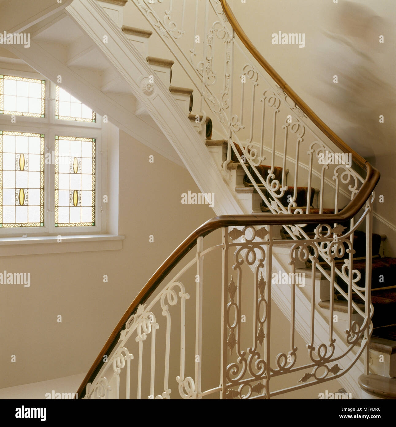 A Detail Of A Traditional Curving Staircase Decorative Wrought | Decorative Handrails For Stairs | Brushed Nickel | Popular | Corner Interior Stair | Exterior Irregular Stair | Iron Staircase