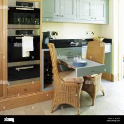 Pull Out Chairs Small Desk Without Wheels Wicker At Breakfast Bar In Country Style Kitchen With Green Fitted Units