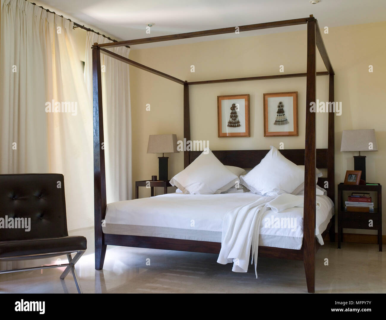 https www alamy com mies van der rohe at foot of four poster bed in modern bedroom image181827855 html