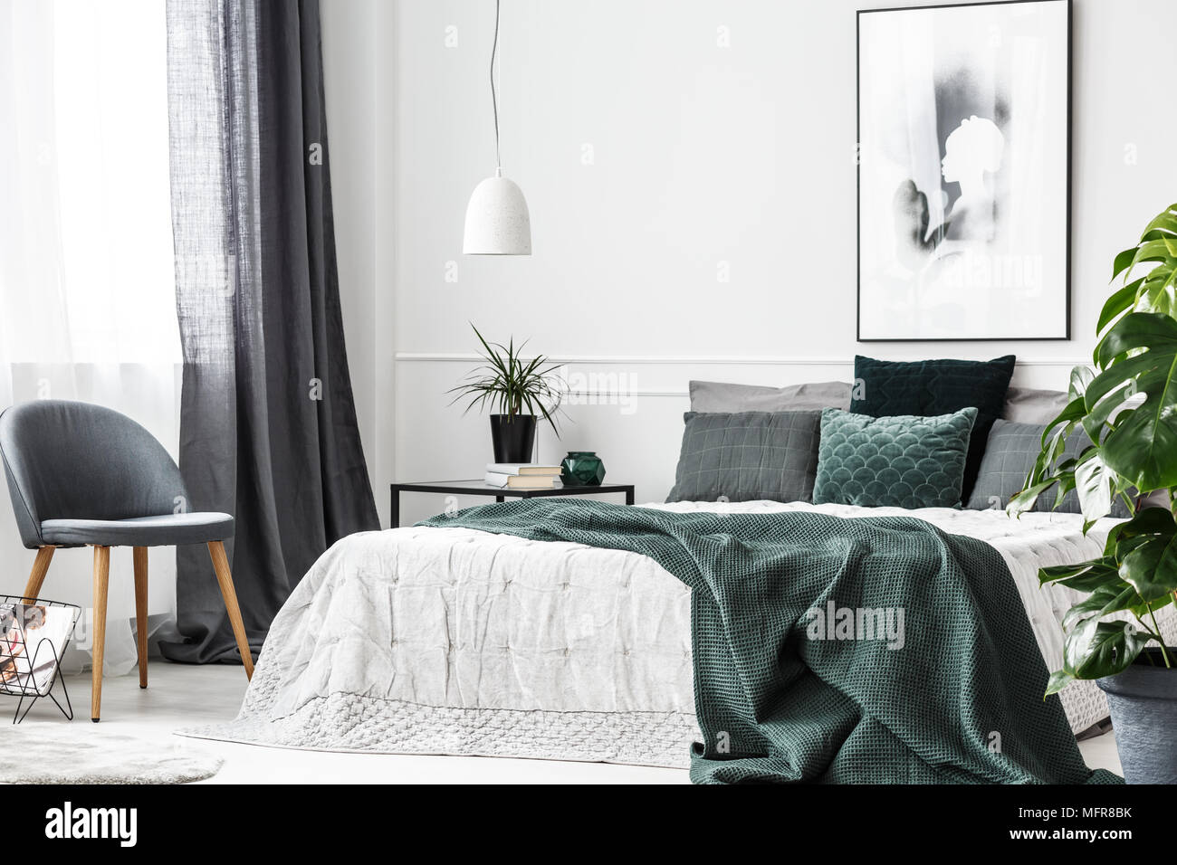 bedroom chair with blanket lounge chairs for kids emerald green and pillows on white bed in cozy interior gray poster