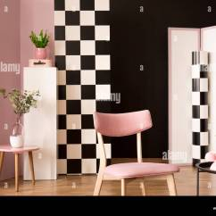 Retro Living Room Decorating Ideas Area Rugs Interior With A Pink Chair Coffee Table Phone Plants And Checkered Wallpaper