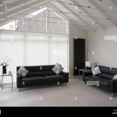 Pictures Of Furnished Living Rooms Chocolate And Turquoise Room Pair Black Leather Sofas In Sparsely Contemporary Sitting