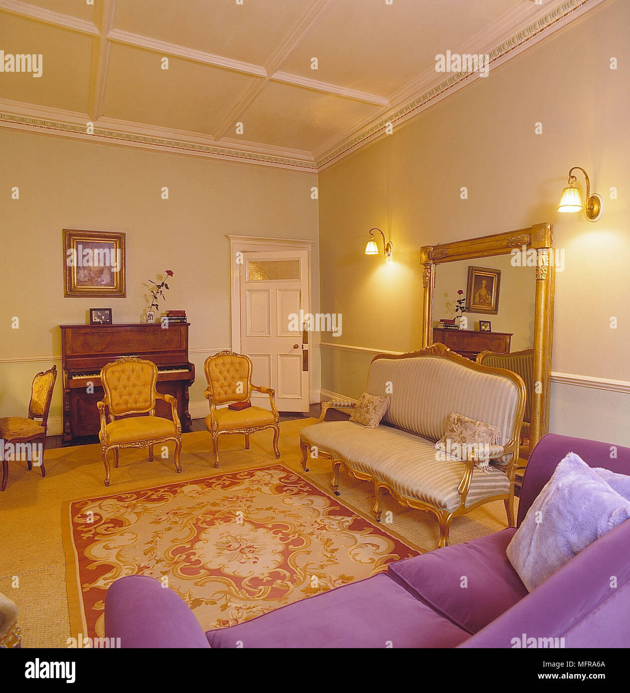 red rug living room ideas the best paint color for sitting yellow walls gold carpet purple couch chairs piano large mirror ineteriors rooms antiques painting wall lights plasterw