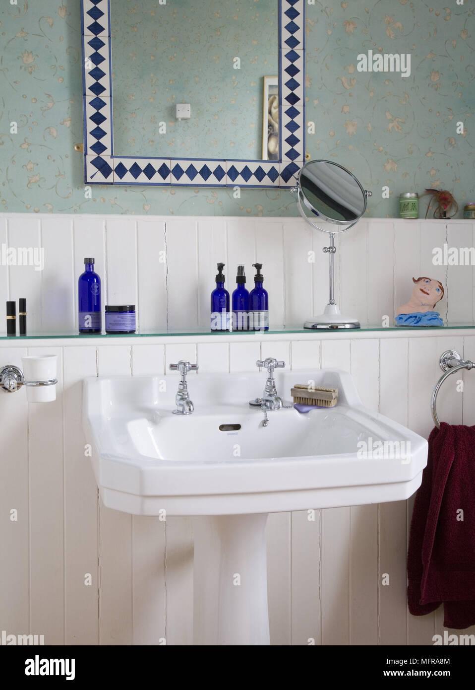 https www alamy com toiletries on glass shelf above victorian style pedestal washbasin in blue bathroom image181836500 html