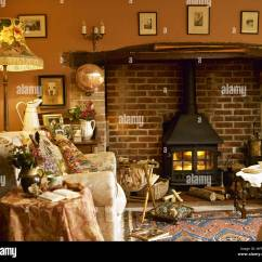 Cosy Living Room With Log Burner Orange Furniture Ideas Inglenook Fireplace Stock Photos Images Country Sitting Wood Burning Stove And Upholstered Armchair