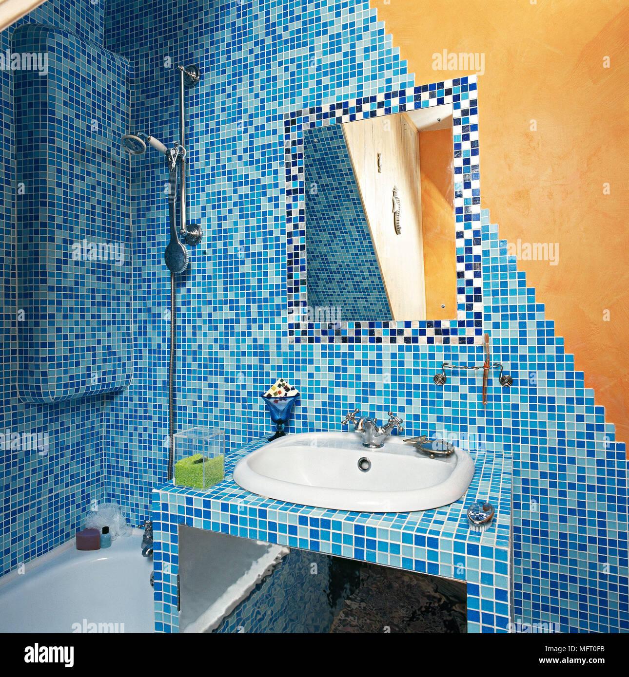 https www alamy com artistic bathroom with blue mosaic tiled walls bathtub sink and mirror image181850799 html