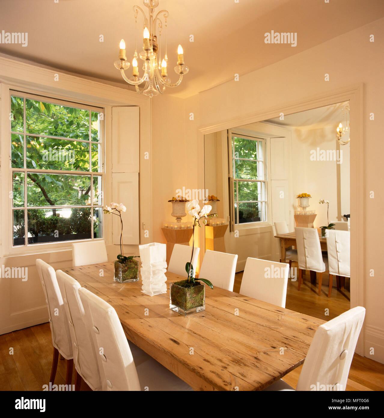 Simple Elegant Dining Room White Walls Long Pine Table