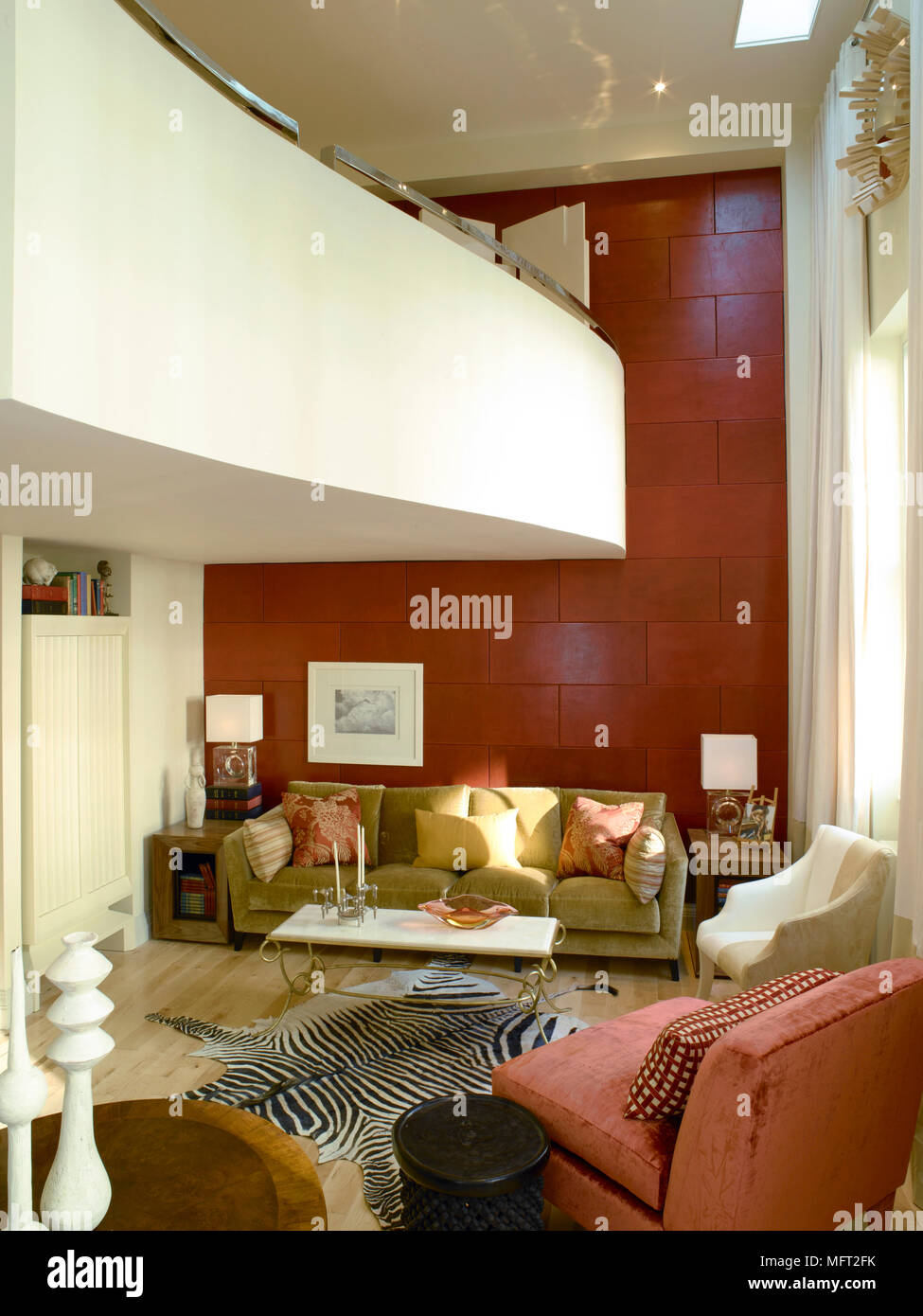 Modern Sitting Room With Red Accent Wall Curving Balcony