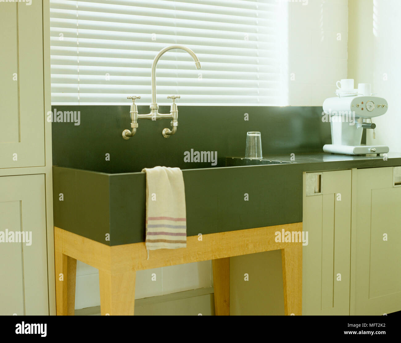 https www alamy com butler sink on wooden legs in kitchen with light green units image181852470 html