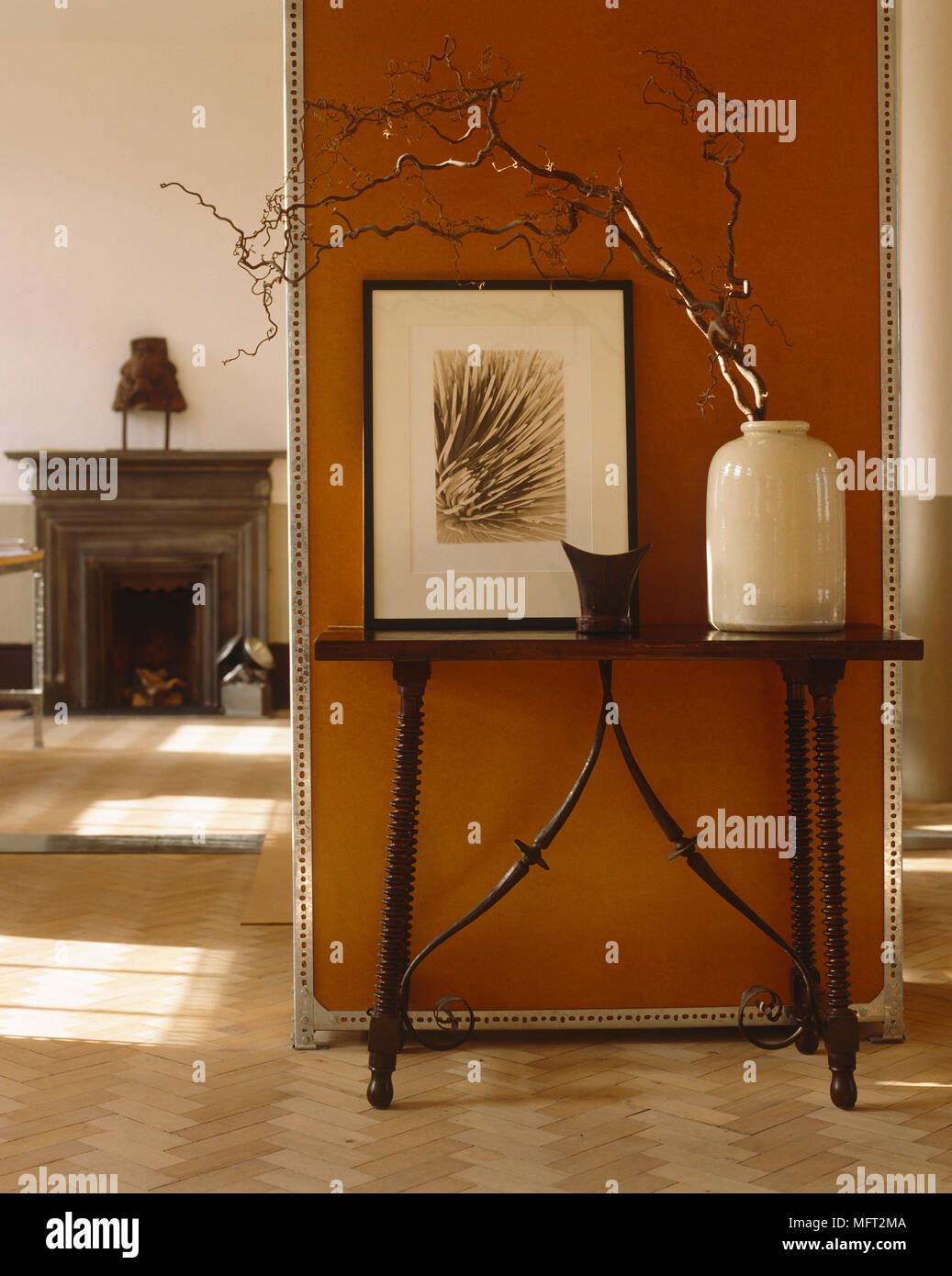 Dark Wooden Side Table Next To Terracotta Wall Stock Photo Alamy