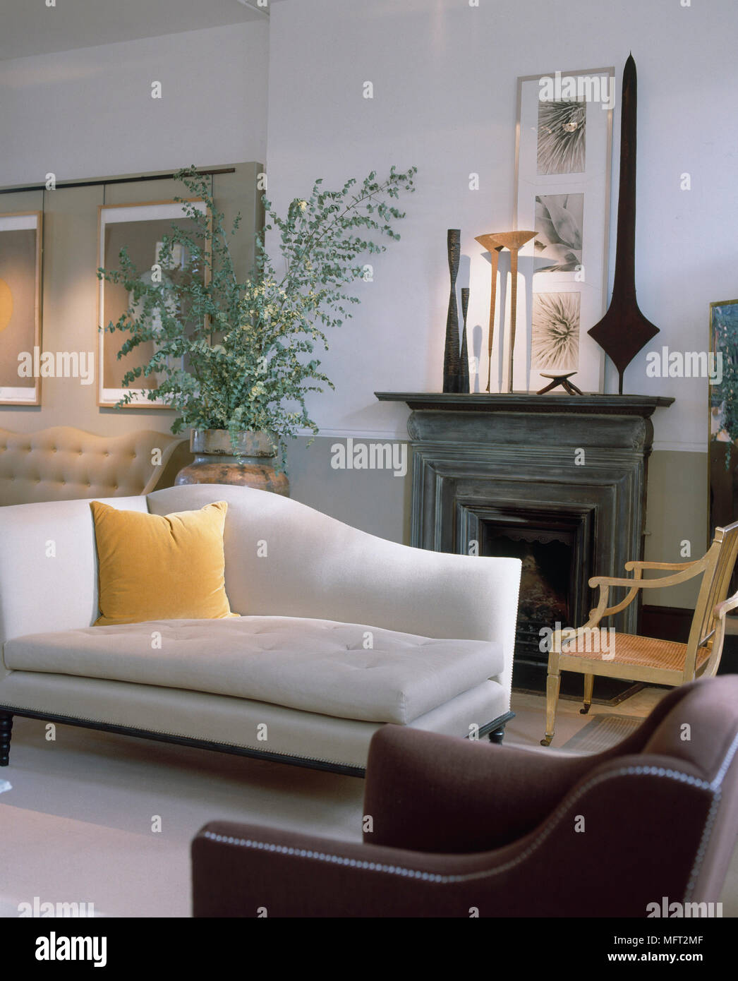 chaise lounges for living room tiles design in nigeria contemporary lounge wall stock photos sitting with white and green walls framed artwork fireplace sculpture cream
