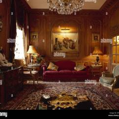 Traditional Living Rooms With Oriental Rugs Corner Of Room Ideas Sitting Wood Panelled Walls Rug Velvet Sofa And Crystal Chandelier