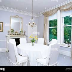 Grey Painted Chairs Cheap Plastic Online A Traditional White Dining Room With Floor Boards Table Covered In Scandinavian Style