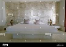 King Size Bed With Marble Platform Tiled Wall In