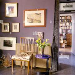 Unusual Wooden Chair Yoga Dvd Eclectic Sitting Room Detail With A Tile Floor Framed Artwork And An Doorway To Adjacent