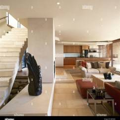 Open Plan Staircase In Living Room Small Sofas For Modern Sitting Kitchen Area Stone Walls Flooring Stairs Sofa Interiors Rooms Spaces Neutral Natural Materials Colours