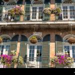 Hanging Planters And Window Boxes Hanging From A Wrought Iron Balcony In The French Quarter Of New Orleans Louisiana Stock Photo Alamy