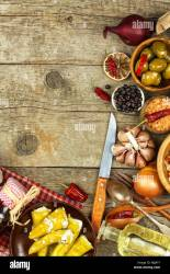 Food ingredients on a wooden background Place for text Restaurant menu Recipe for chefs Spices and stuffed green olives Stock Photo Alamy