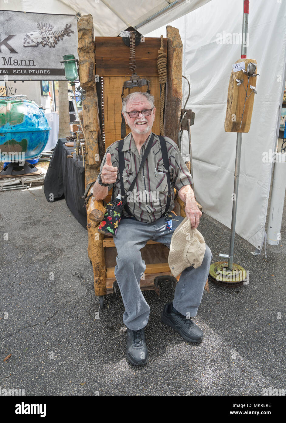florida electric chair aeron review 2017 spring festival in gainesville features a variety of expression and experiences man tries out wooden creation for sale