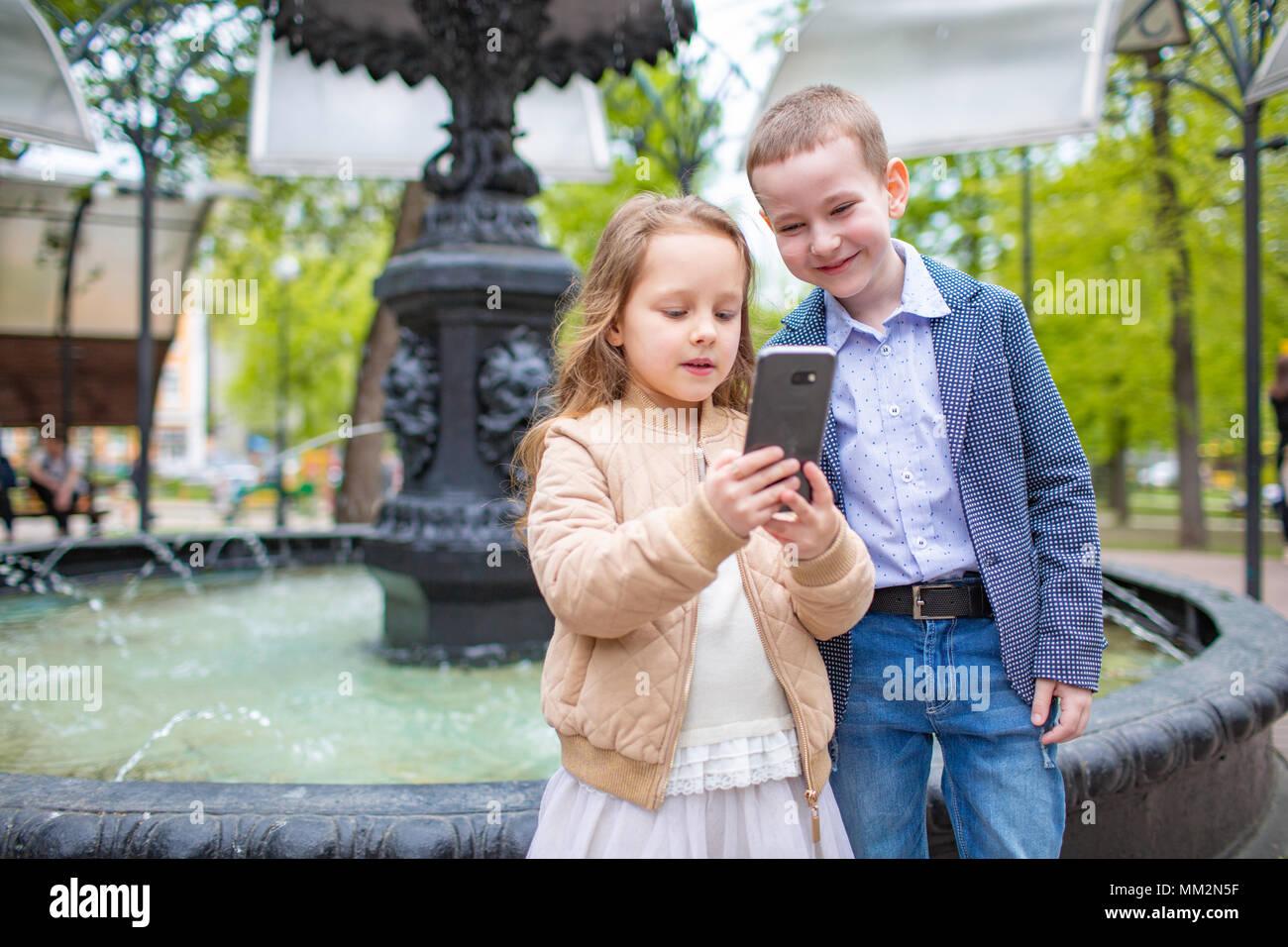 two little kids taking