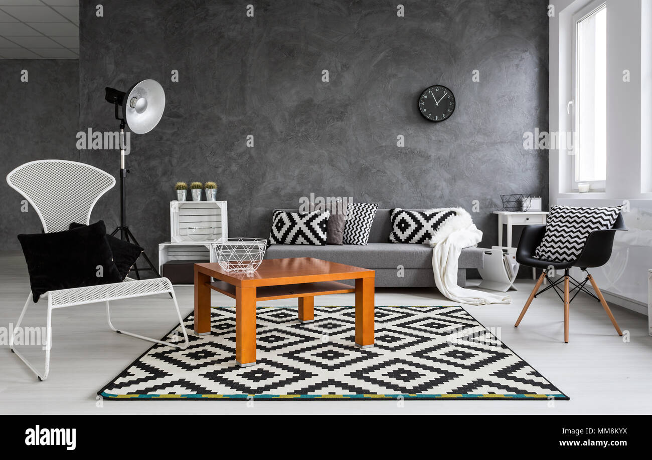 Grey Living Room With Sofa Chairs Standing Lamp Small Wood Table And Pattern Decorations In Black And White Stock Photo Alamy