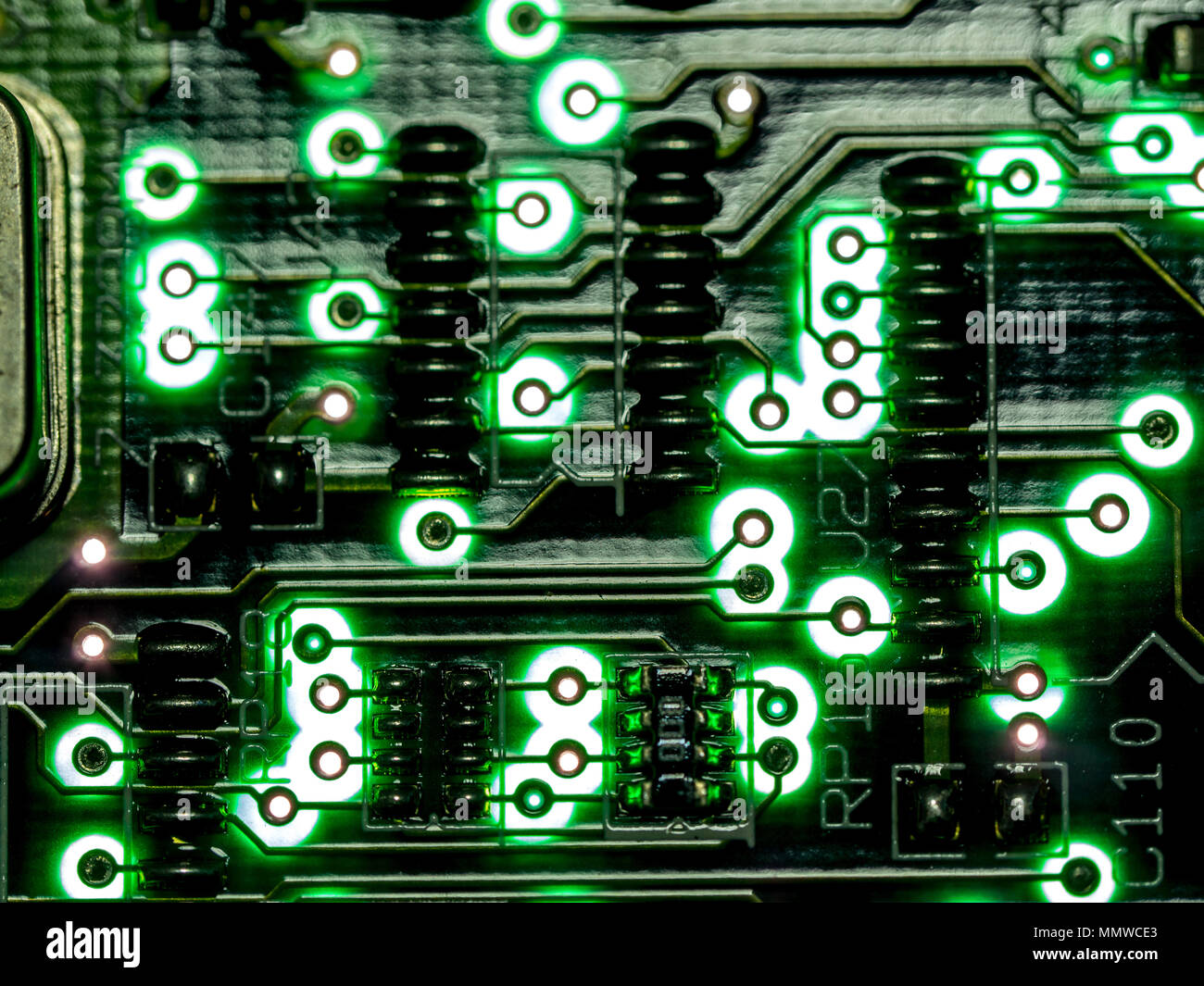 Close Up Of Computer Hard Drive Circuit Board In Neon Colors