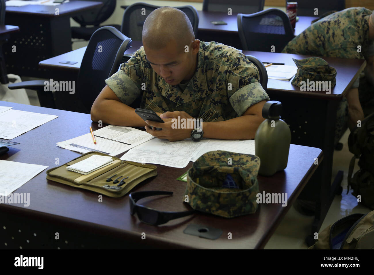 Camp Foster Okinawa Japan Lance Cpl Michael Li Calculates His Monthly Spending During A