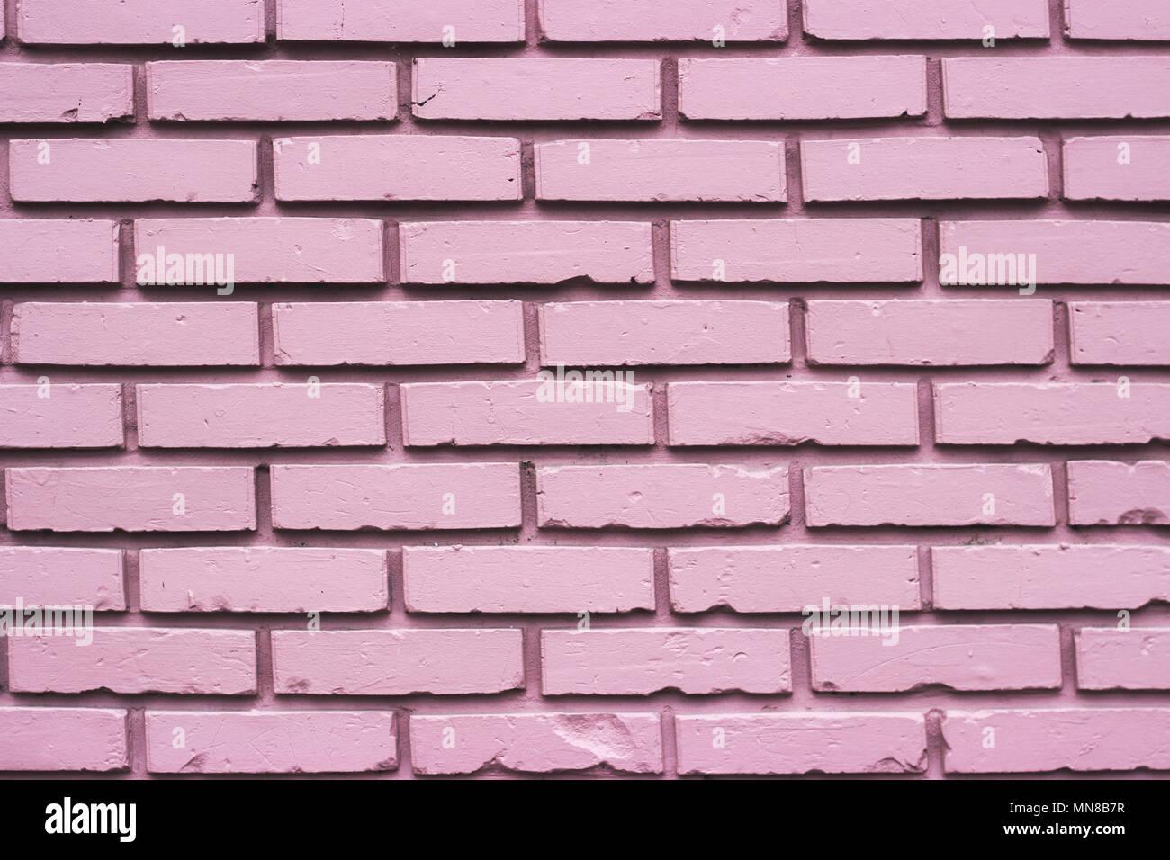 pink brick wall stock
