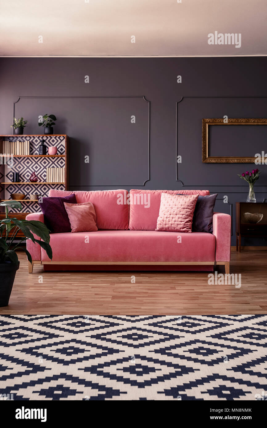 dark grey living room carpet discount chairs for pink velvet couch with cushions standing in the middle of interior molding on wall and geometric