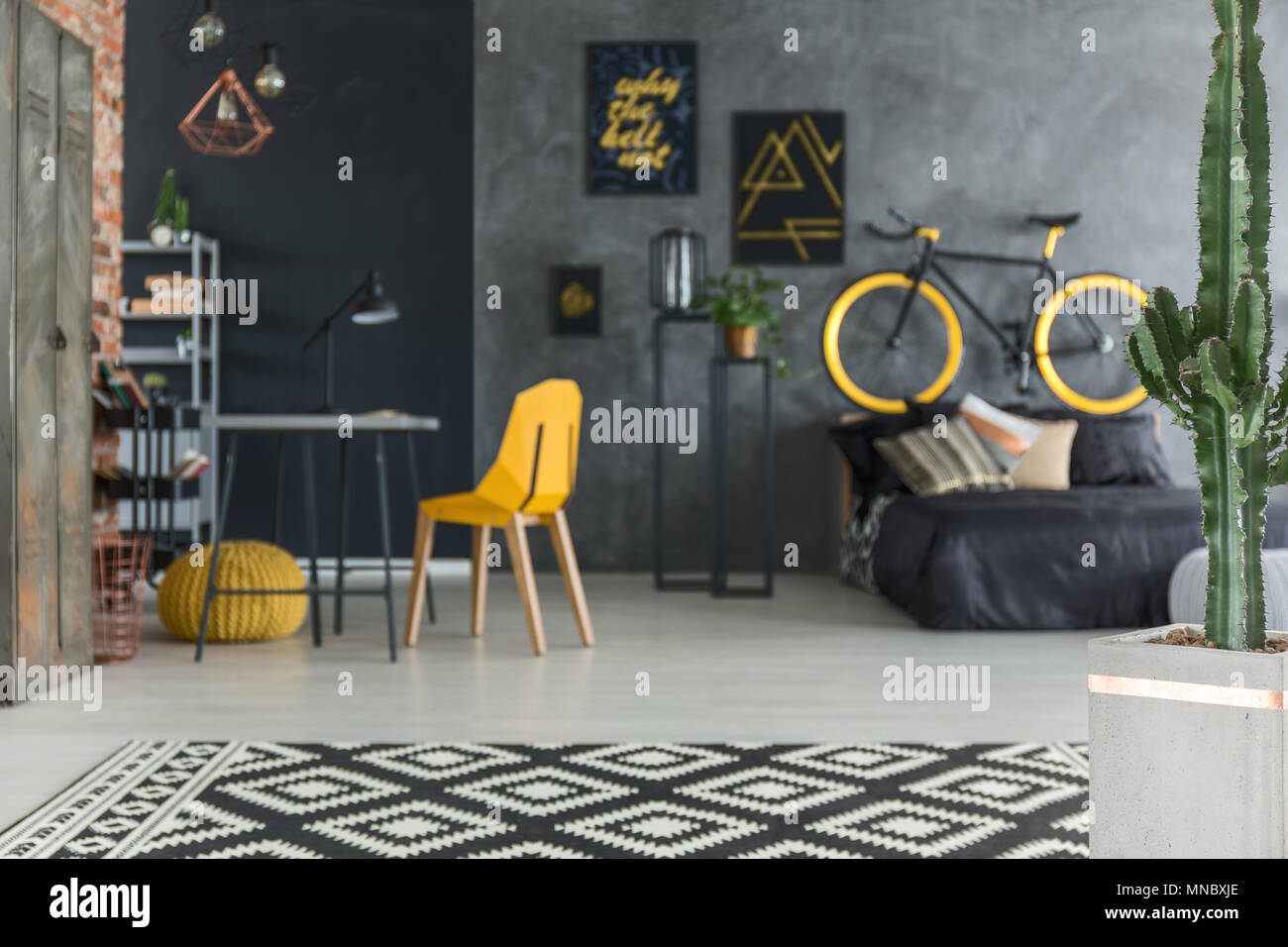 yellow and grey chair cover hire dunstable hipster room with bed bike desk stock photo
