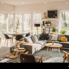 Living Room Round Table Design With Grey Sofa Wooden Dining In The Corner Of An Open Space Interior Nordic Furniture And Decor