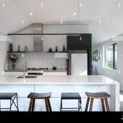 White Kitchen Bench Molding For Cabinets Interior With And Barstools At Breakfast Bar Korokoro House Wellington New Zealand Architect Solari Architects 2018