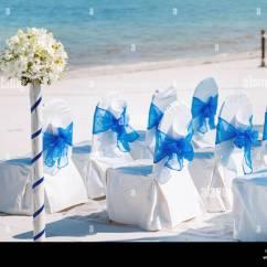 Blue Spandex Chair Covers Folding Tesco The Random White Chairs Cover With Organza Sash Decoration Waiting For Beach Wedding Venue Setup